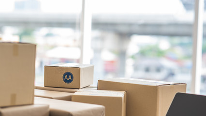 Paper boxes on table in white window background, online shopping concept
