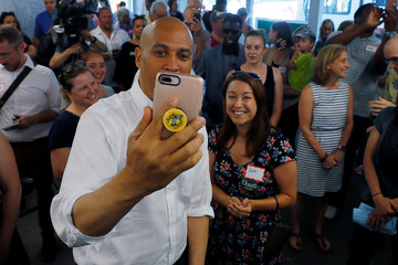 Democratic 2020 U.S. presidential candidate Booker records a video on a teacher's mobile phone in Manchester