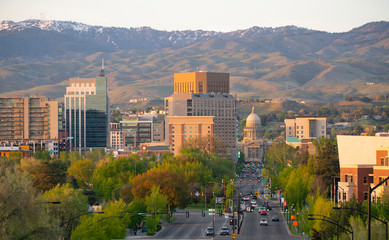 The Idaho State Capital Building Peaks Out Between Structures in Boise