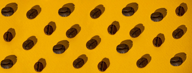 the pattern of coffee beans on colored background