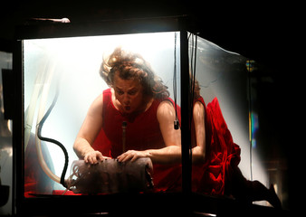 "Danish musician Laila Skovmand vocalises and plays the hydraulophone underwater in a glass water tank during ""AquaSonic"", a submerged musical performance, at the Malta International Arts Festival in Valletta"