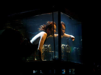 "Danish musician Nanna Bech vocalises underwater in a glass water tank during ""AquaSonic"", a submerged musical performance, at the Malta International Arts Festival in Valletta"