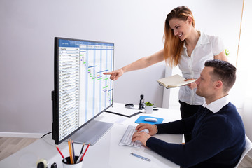 Businesswoman Pointing At Screen While Analyzing Gantt Chart
