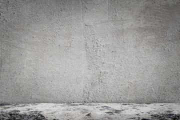 Concrete floor with empty grey concrete wall background.