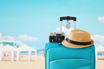 Wall Mural - recreation image of traveler luggage, camera and fedora hat infront of tropical background. holiday and vacation concept