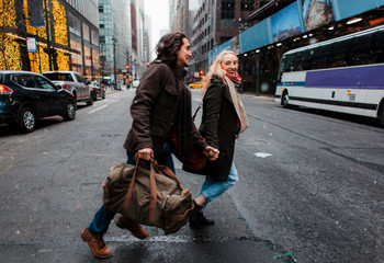 Excited vacationers walking on the streets of New York City