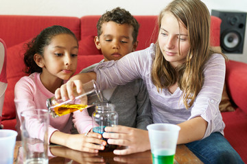 Kids science experiment with colored liquids