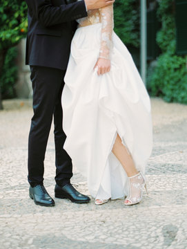 Close up shot of couple in a wedding gown and a suite