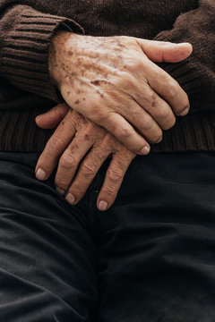 Closeup of an elderly man hands