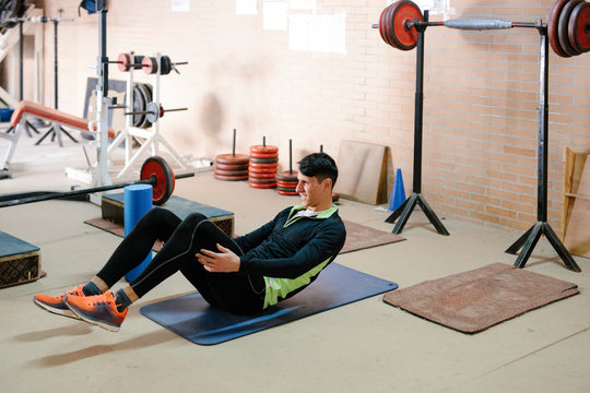Young man working out in gym