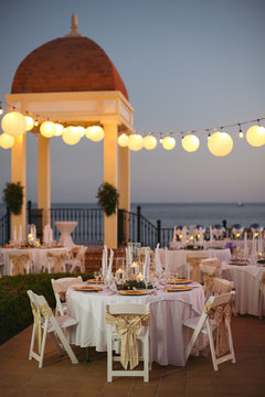 Wedding reception table and decor at dusk