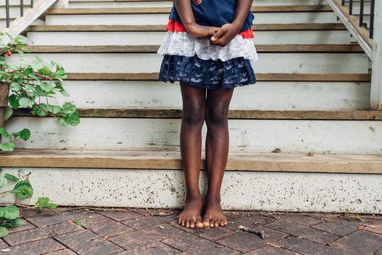 African American girl wearing an American flag colors skirt