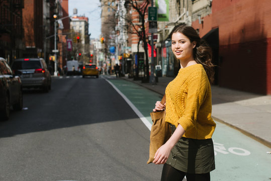 Young woman walking in New York City
