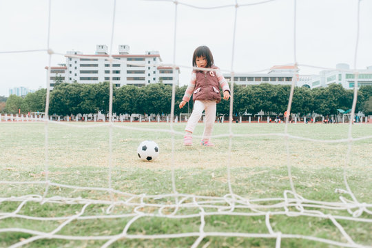 little girl playing football