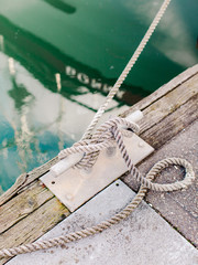 Close up of knot of boat tied at dock