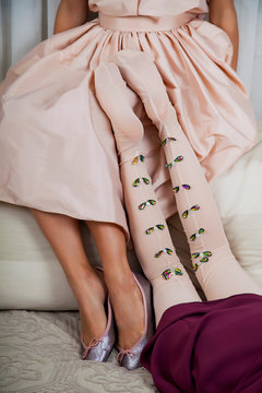 Female legs in a pink dress