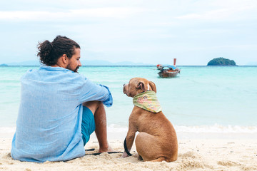 Dog and a man at the beach