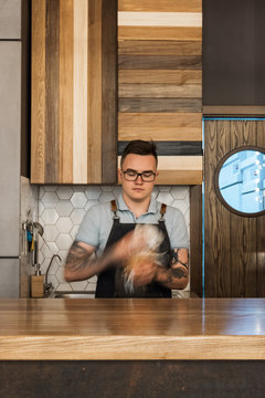 Barista with glass cup in hands