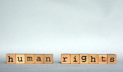 The text 'Human Rights' written with small wooden blocks (typographical stamps), copy space for text