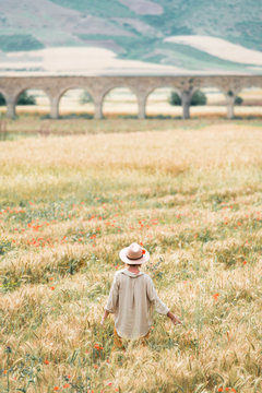 Young girl enjoining summer in a field