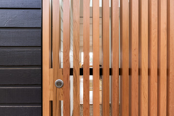 Close up background of a drying room door of wooden slats