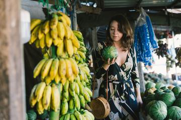 Woman Traveler Browsing A Fresh Fruit Market On Vacation