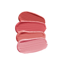 Lipstick brush strokes in different shades of pink nude color. Makeup swatch smudge isolated on white background. Cosmetic product texture.