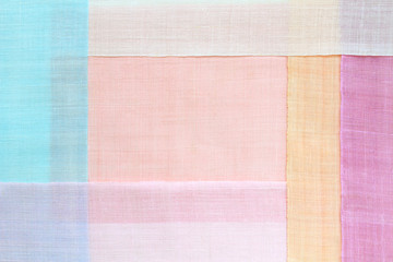 Traditional patchwork background of ramie fabric. Pastel tone. Wall mural