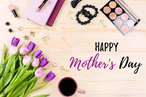 Happy Mother's Day greeting card with stationery, fashion accessories, flowers and make up products. Woman work desk
