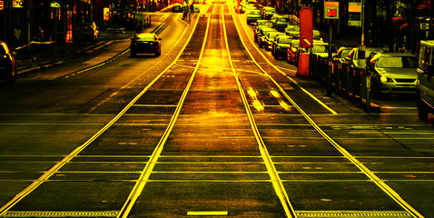 Melbourne city tram tracks are glowing with golden afternoon sunlight captured through a vintage camera lens