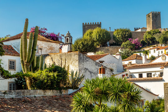 View of Obidos, Portugal. A small town surrounded by medieval castle walls. Popular touristic destination near Lisbon.