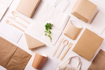Obraz Catering and street fast food paper cups, plates and containers. Eco-friendly food packaging on white background with copy space. Flat lay. Top view. Carering of nature and recycling concept. - fototapety do salonu