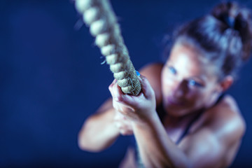 Woman athlete exercising on gymnastic rings
