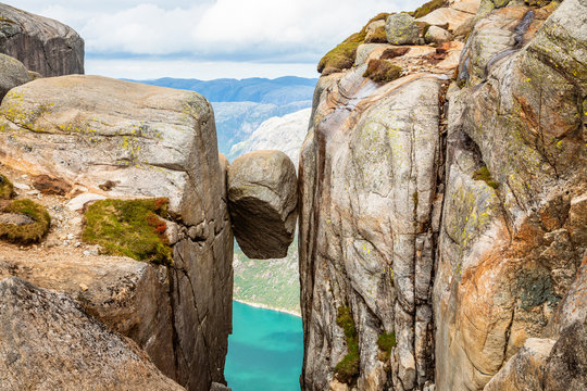 Kjeragbolten, the stone stuck between two rocks with fjord in the background, Lysefjord, Norway
