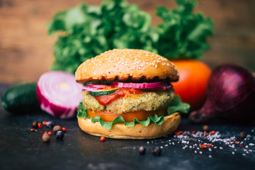 Vegetarian burger (home made burger) with chickpea cutlet and vegetables. Veg concept. Copy space.