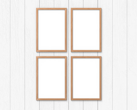 Set of 4 vertical wooden frames mockup with a border hanging on the wall. Empty base for picture or text. 3D rendering.