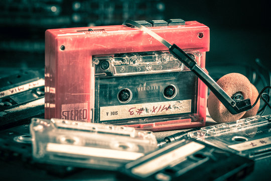 Classic cassette tape with red walkman and headphones