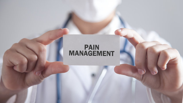 Doctor holding card. Pain Management
