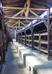 Auschwitz-Birkenau, Poland - June 27, 2019 German concentration camp Birkenau. The interior of the barrack with prison bunks.