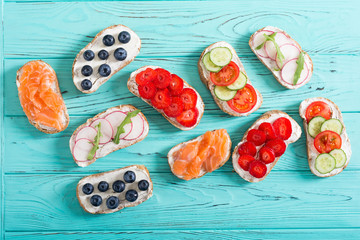 Variation of toast with fruit , vegetable and salmon