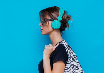 Young woman in zebra clothes and headphones
