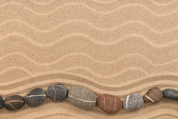 Stones in the form of a zigzag lies on the dunes. With space for design, text place. Wall mural