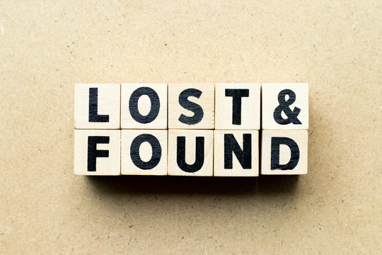 Letter block in word lost & found on wood background