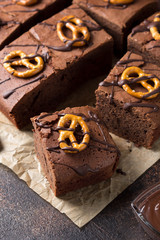 Chocolate brownie on dark beer with salted pretzels and chocolate. Delicious brutal dessert for men, sweet food