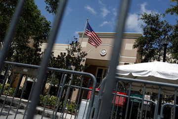 An American flag flies at ICE facilities as communities brace for a reported wave of ICE deportation raids in Miami