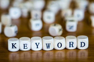 Keyword written with wooden cubes