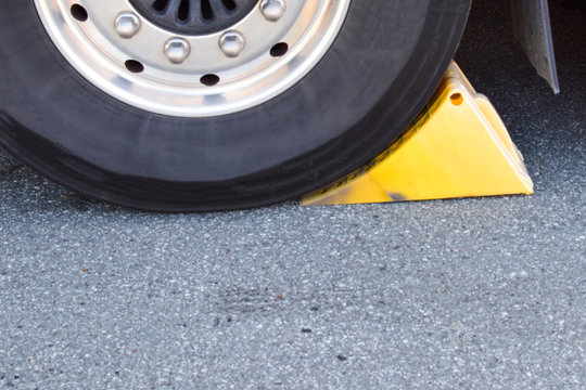 Wheel chocks. Device for safe parking of a truck.