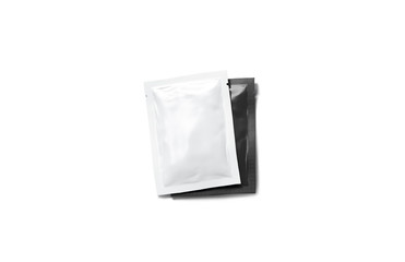 Blank white sachet packet on black stack mockup, isolated, top view, 3d rendering. Empty seasoning case with salt covering pepper mock up. Clear condiment pair with sauce for food.