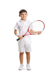 Child with a tennis racket smiling at the camera
