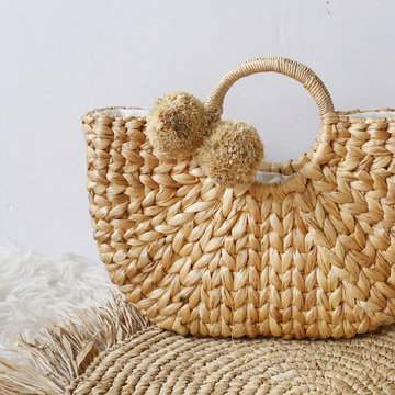 fashionable handmade natural organic rattan bag. Trandy bamboo eco bag from bali isolited on white background